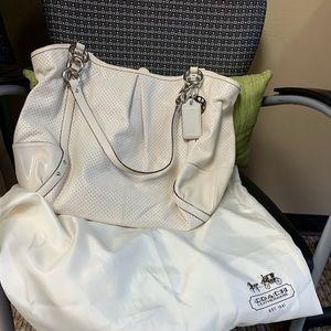 White brand new coach bag